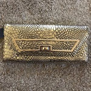 Gold Clutch. Super cute, never been used.